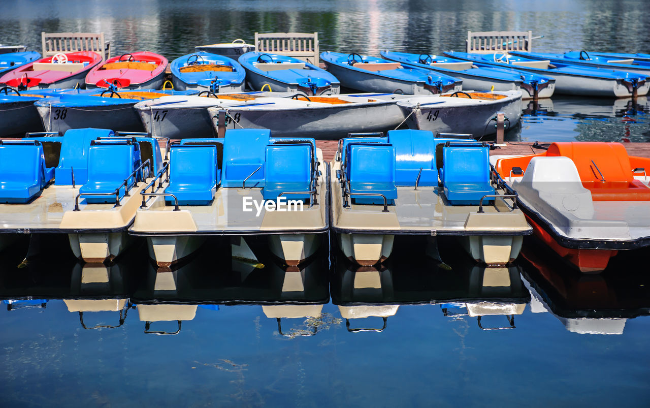 Row Of Boats Moored In Water