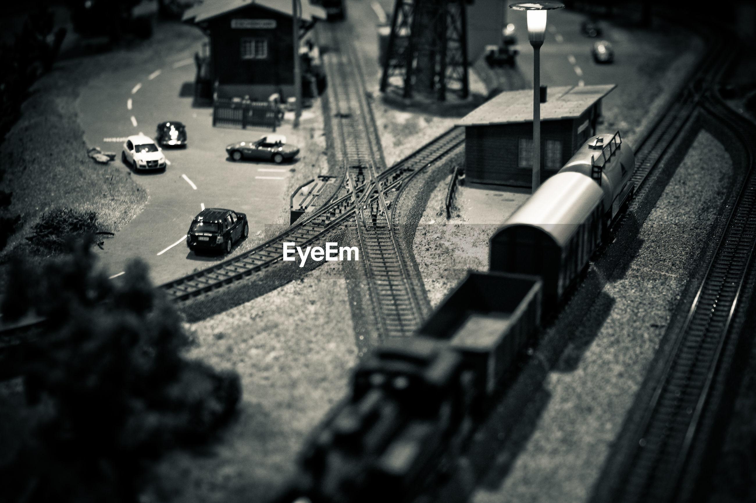 Tilt-shift image of train and cars