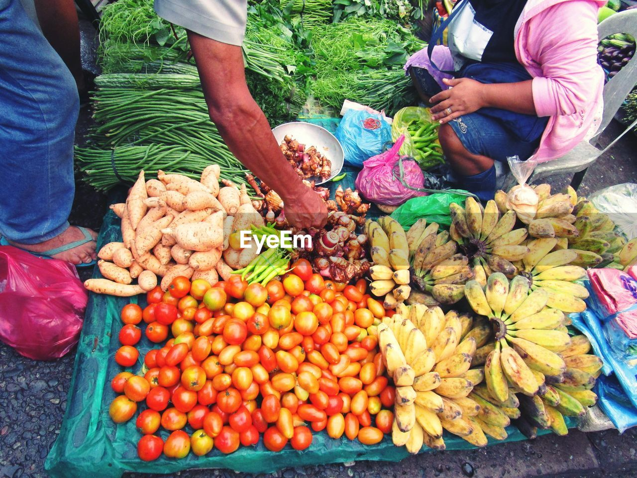 vegetable, food, food and drink, real people, retail, market, freshness, healthy eating, day, choice, men, for sale, business, market stall, wellbeing, high angle view, people, midsection, large group of objects, variation, buying, hand, outdoors, sale