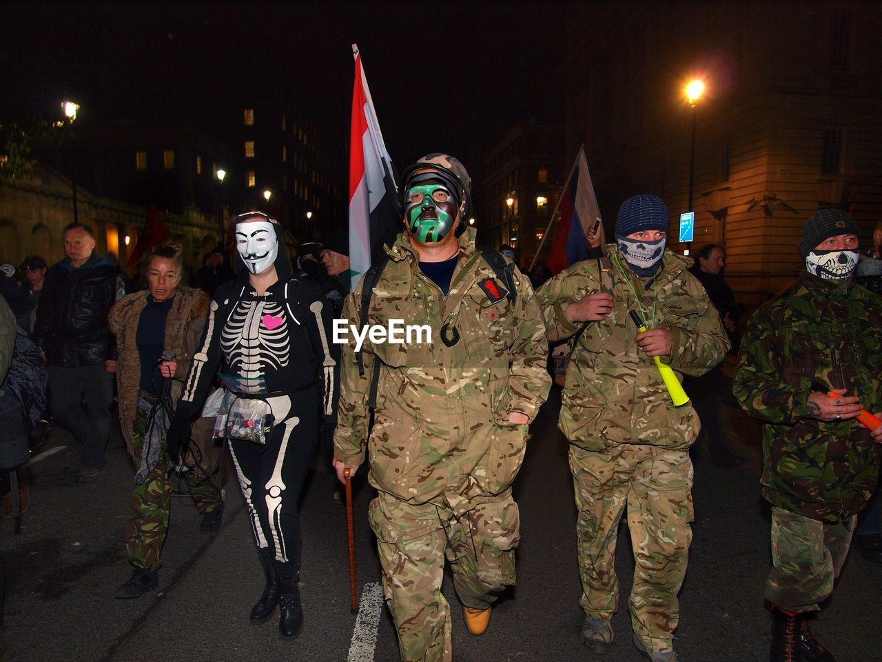 night, large group of people, real people, costume, lifestyles, men, outdoors, togetherness, camouflage clothing, headwear, people, adult