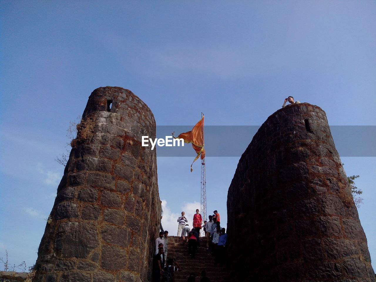 Low Angle View Of People In Fort Against Sky