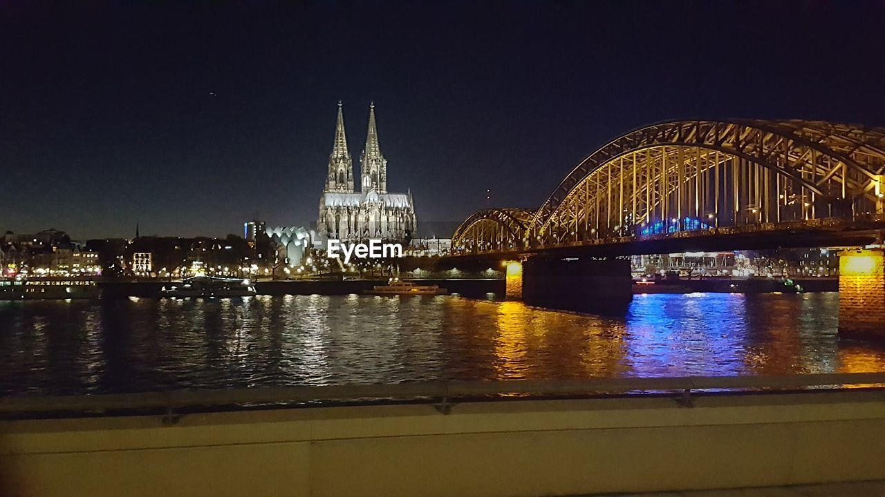 architecture, built structure, night, illuminated, travel destinations, building exterior, water, connection, bridge - man made structure, travel, no people, sky, outdoors, city, cityscape, clear sky
