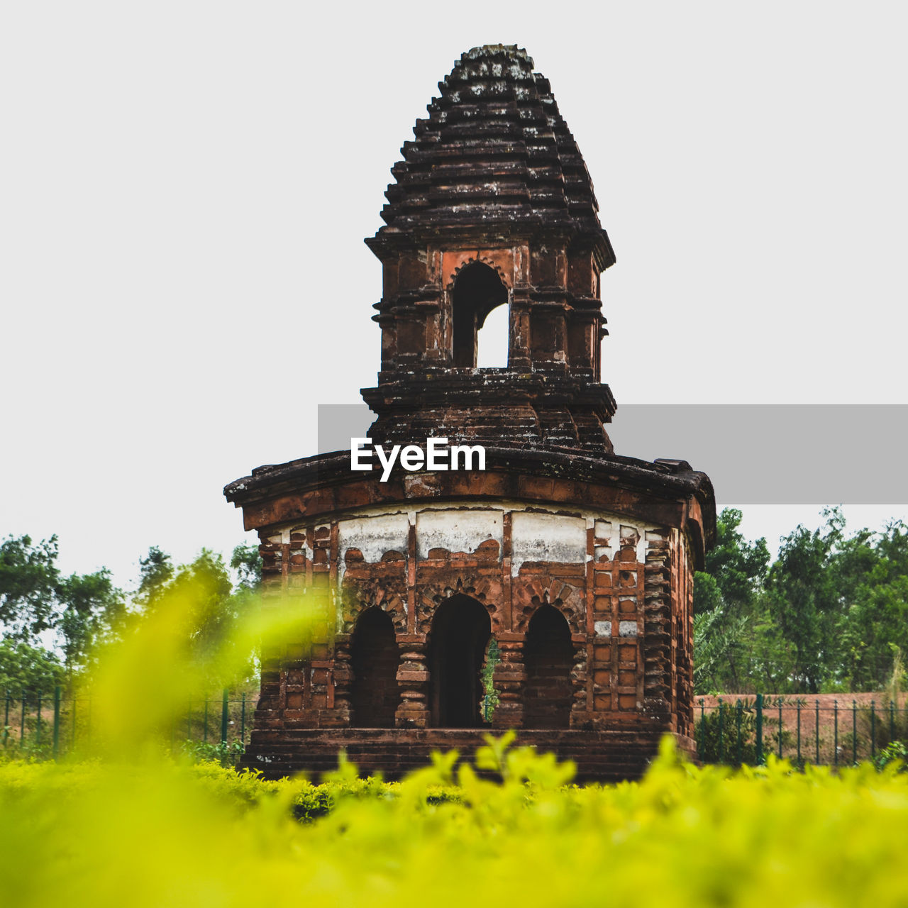 architecture, built structure, building exterior, religion, place of worship, low angle view, history, spirituality, clear sky, old ruin, travel destinations, day, outdoors, ancient, no people, tree, nature, ancient civilization, sky