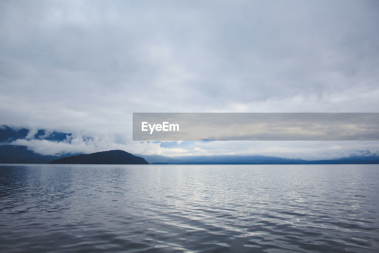 cloud - sky, water, sky, scenics - nature, tranquility, beauty in nature, waterfront, tranquil scene, sea, nature, no people, day, idyllic, non-urban scene, mountain, remote, outdoors, rippled, horizon over water