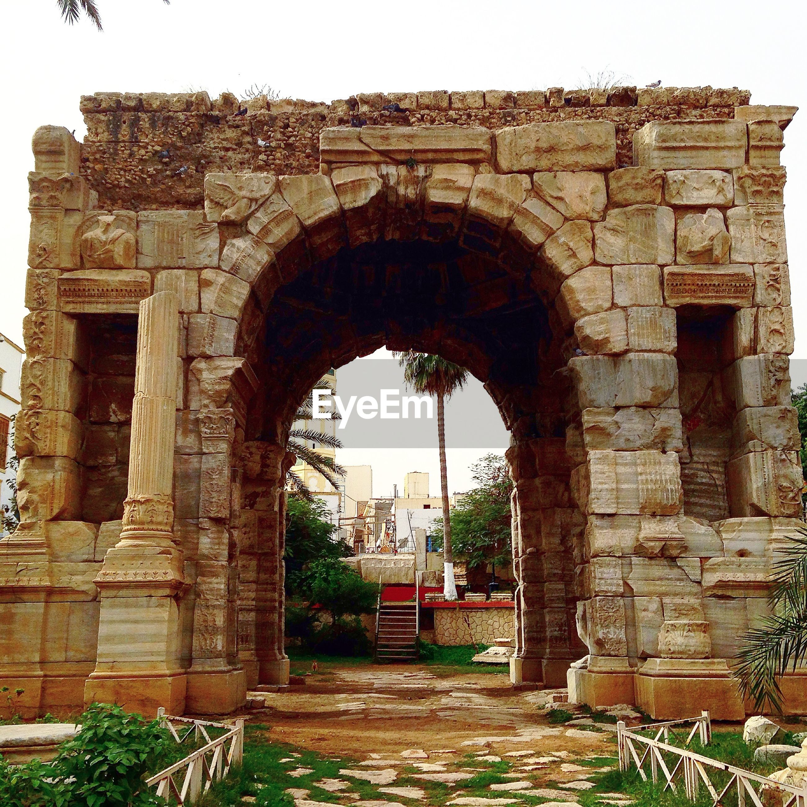 architecture, built structure, arch, building exterior, history, old, archway, old ruin, the past, ancient, stone wall, historic, arched, entrance, ancient civilization, sky, day, clear sky, abandoned, famous place