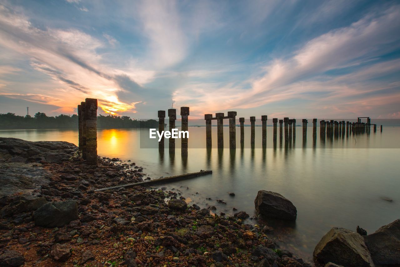 water, sky, sunset, cloud - sky, nature, outdoors, architecture, sea, no people, built structure, scenics, beauty in nature, beach, building exterior, horizon over water, day