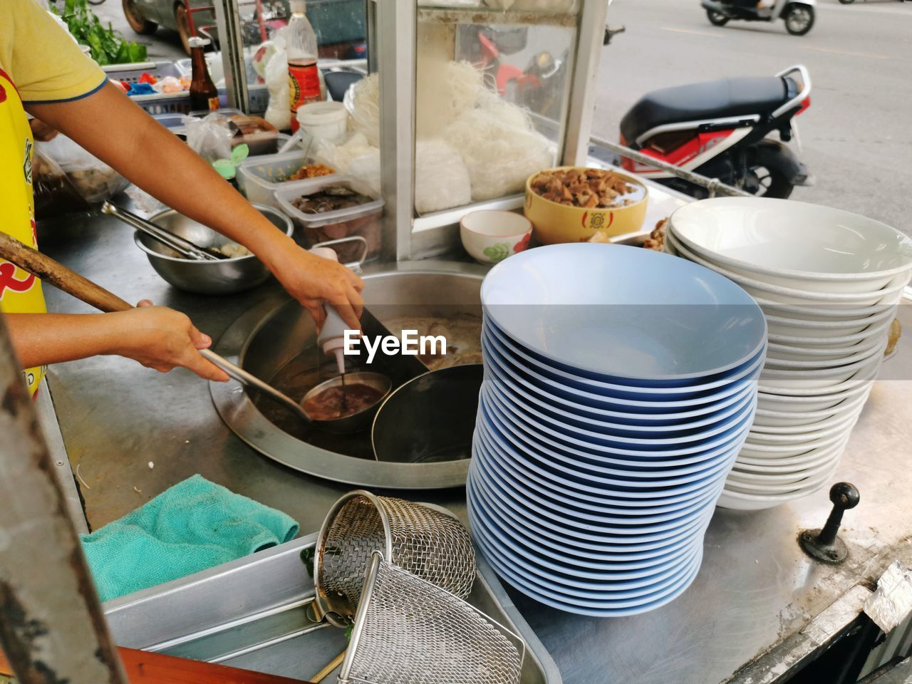 Midsection of man preparing food at stall