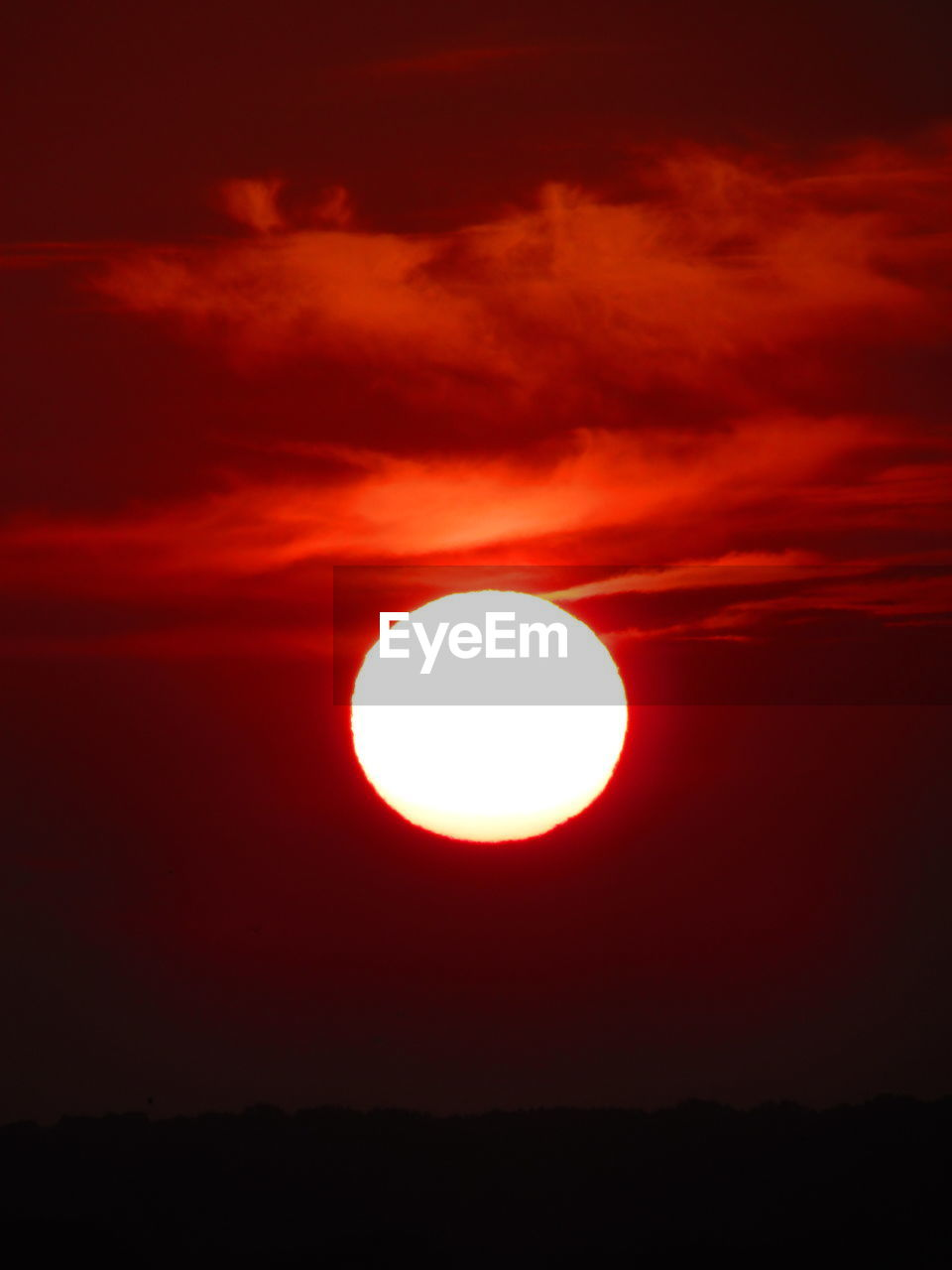 sun, beauty in nature, sky, scenics, orange color, sunset, tranquil scene, nature, outdoors, moon, solar eclipse, low angle view, cloud - sky, silhouette, red, no people, natural phenomenon, sunlight, tranquility, technology, astronomy, day