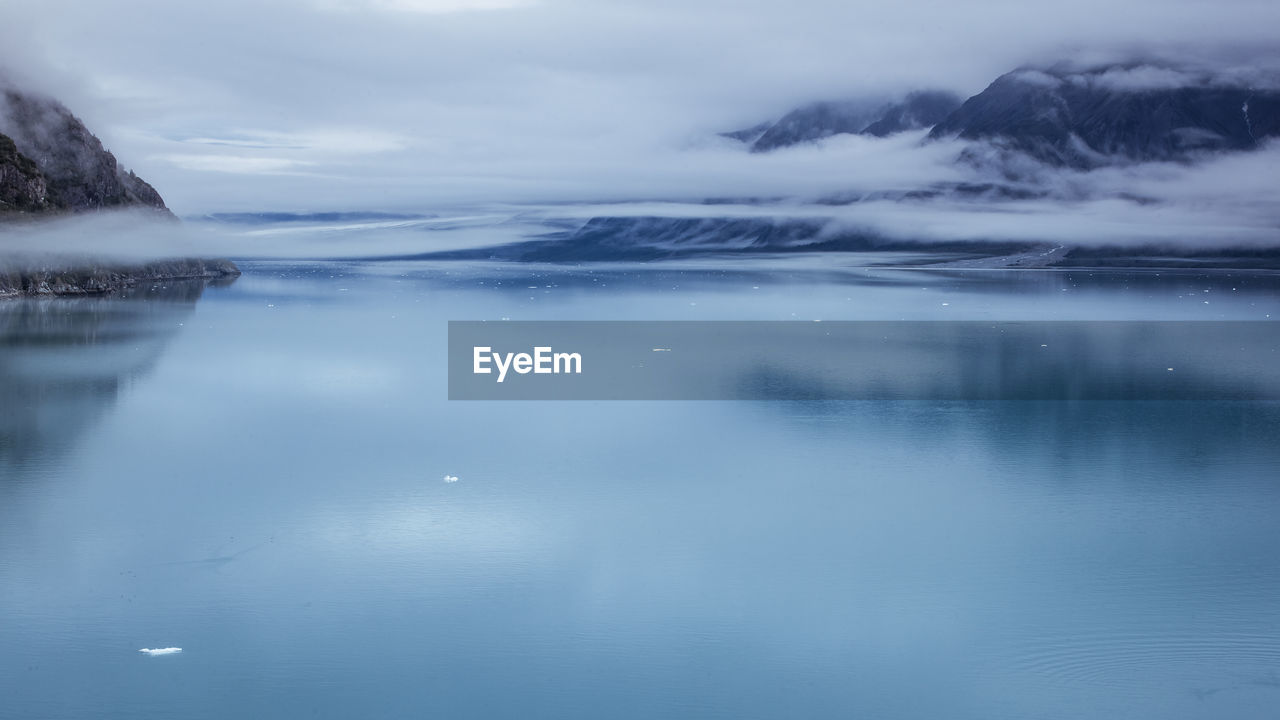 sky, water, cloud - sky, scenics - nature, waterfront, reflection, beauty in nature, tranquility, tranquil scene, no people, lake, nature, day, cold temperature, idyllic, non-urban scene, outdoors, ice, iceberg