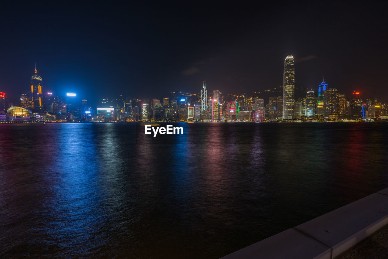 architecture, built structure, night, building exterior, city, illuminated, water, building, landscape, skyscraper, urban skyline, office building exterior, cityscape, sky, waterfront, modern, river, tall - high, no people, outdoors, financial district