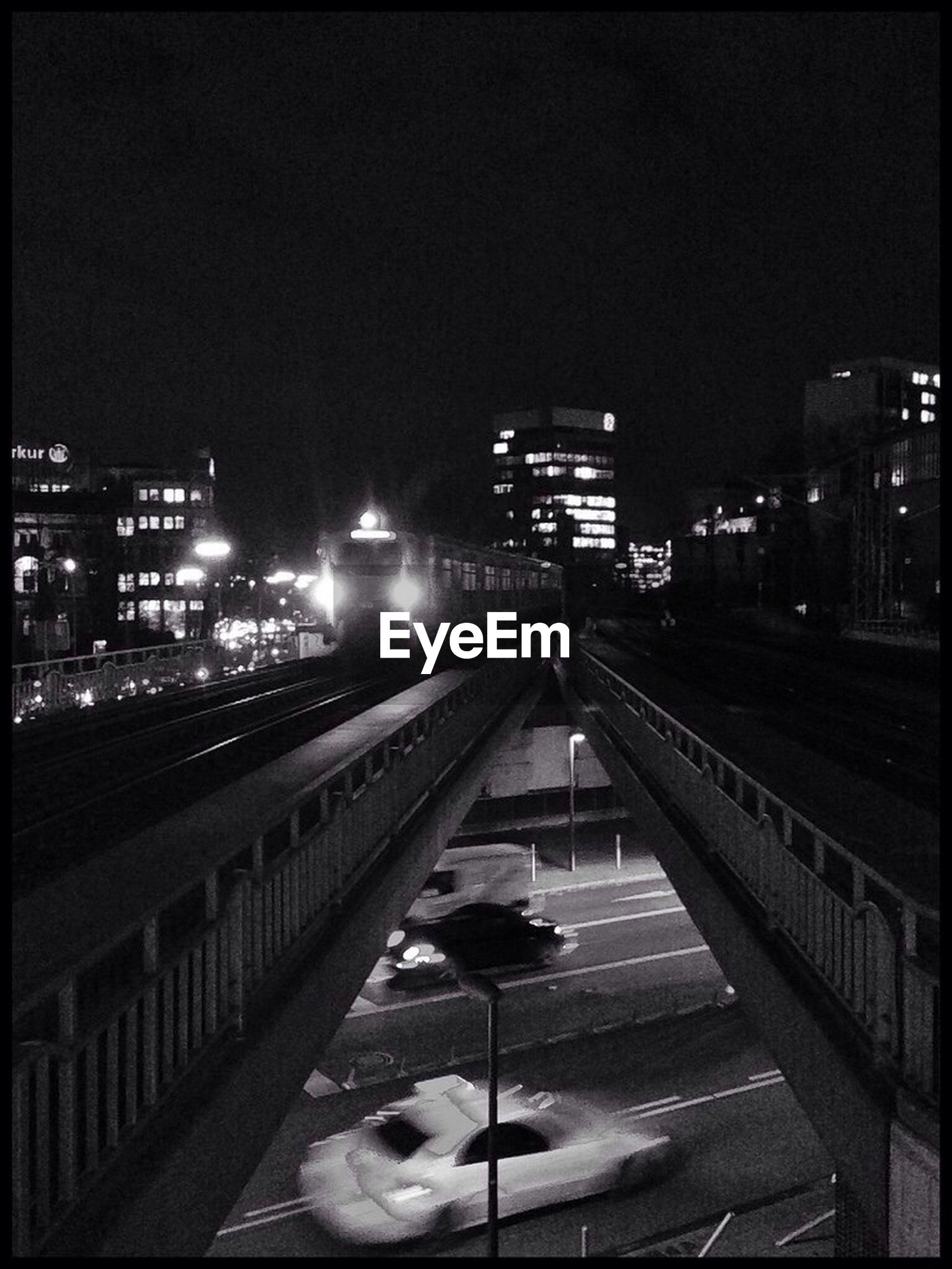 Train on railway bridge at night