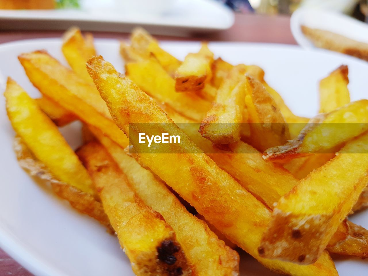french fries, prepared potato, food, potato, ready-to-eat, food and drink, unhealthy eating, fried, close-up, freshness, fast food, deep fried, indoors, yellow, still life, no people, plate, serving size, snack, focus on foreground, fast food french fries, temptation, paper plate, comfort food
