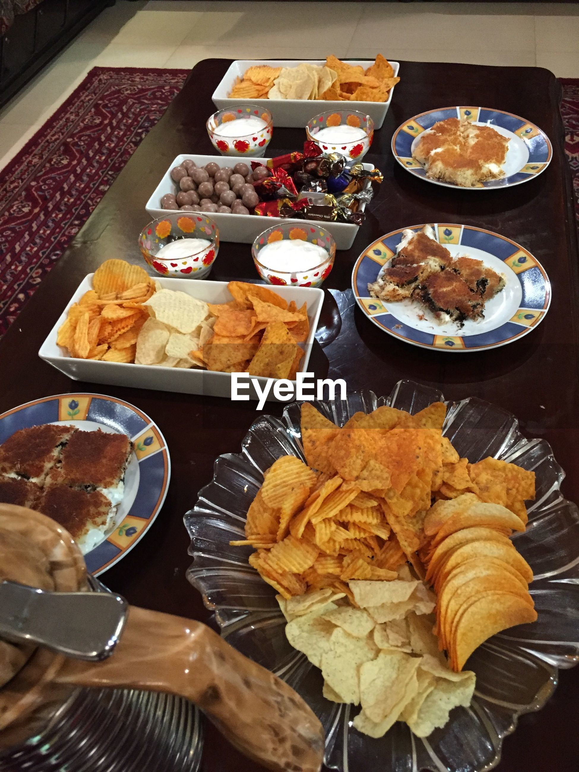 food and drink, food, freshness, indoors, still life, healthy eating, ready-to-eat, variation, table, high angle view, choice, abundance, meal, plate, indulgence, bowl, large group of objects, meat, arrangement, tray