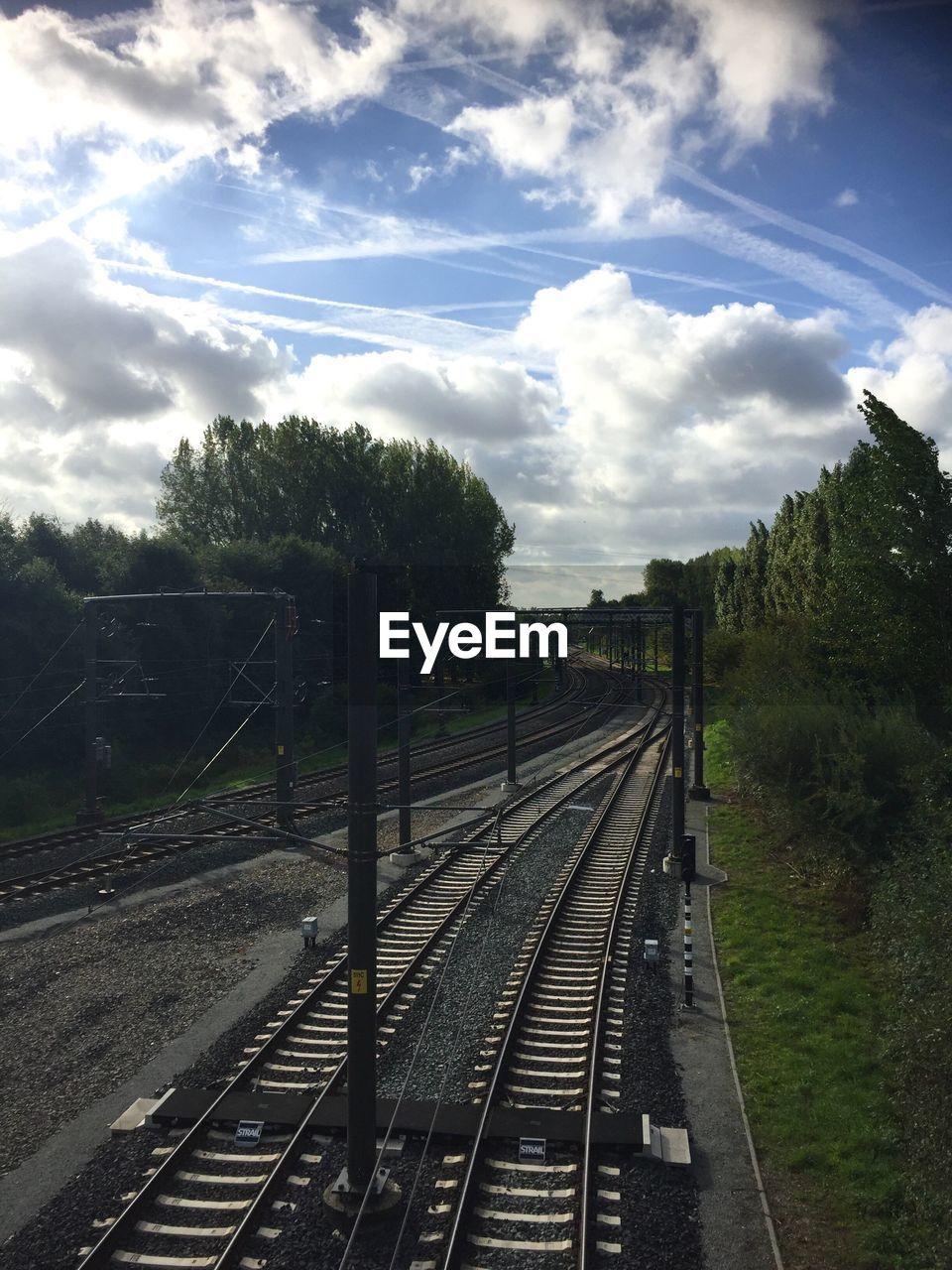 railroad track, transportation, rail transportation, sky, cloud - sky, the way forward, day, no people, railway track, train - vehicle, tree, public transportation, nature, outdoors