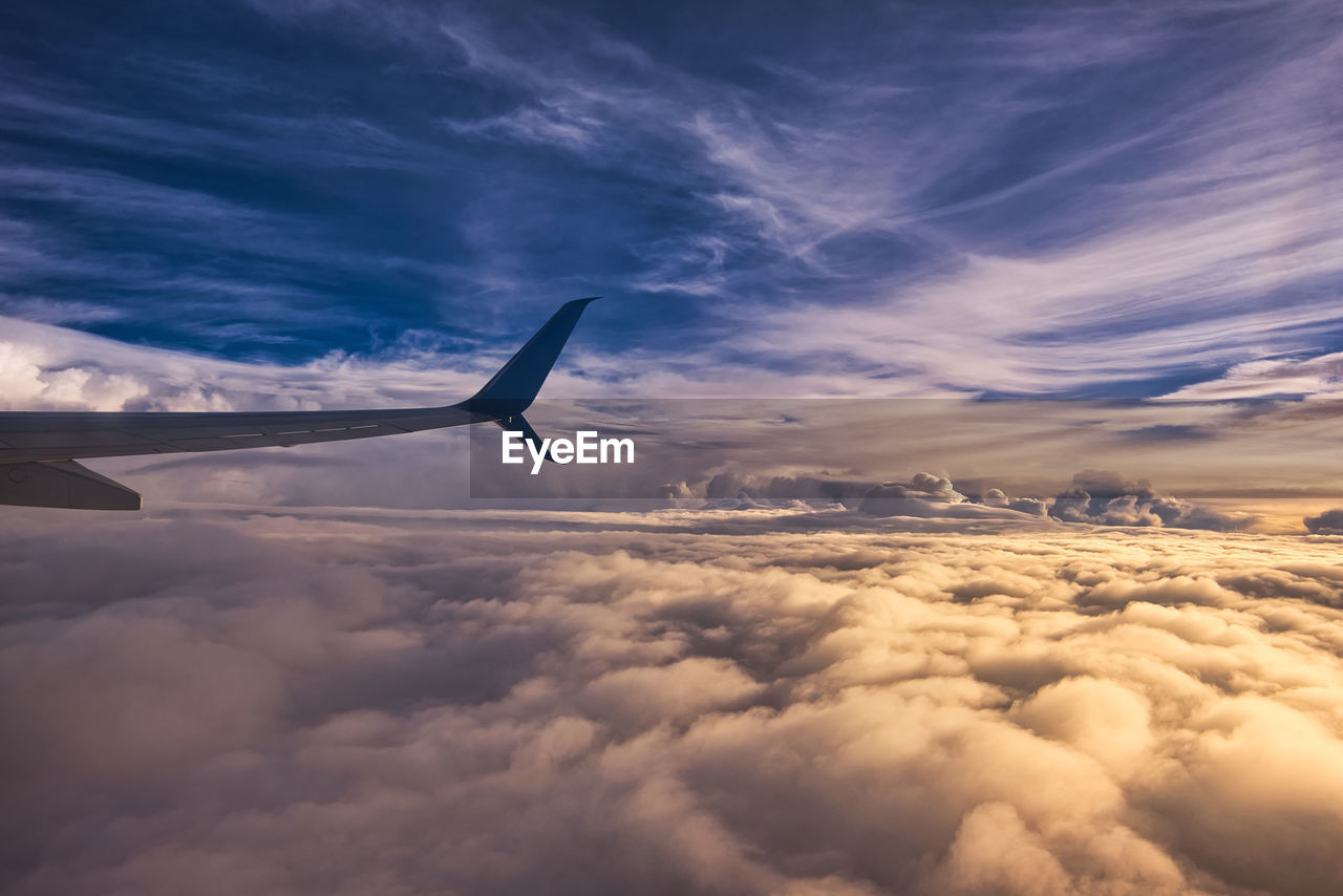 cloud - sky, sky, airplane, air vehicle, flying, beauty in nature, scenics - nature, mode of transportation, mid-air, transportation, sunset, aircraft wing, nature, no people, cloudscape, travel, outdoors, public transportation, commercial airplane, idyllic, plane