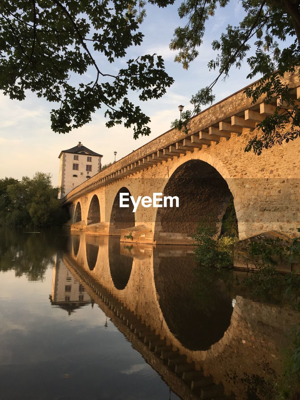 water, reflection, tree, built structure, arch, architecture, plant, sky, bridge, nature, river, connection, bridge - man made structure, no people, waterfront, arch bridge, day, outdoors