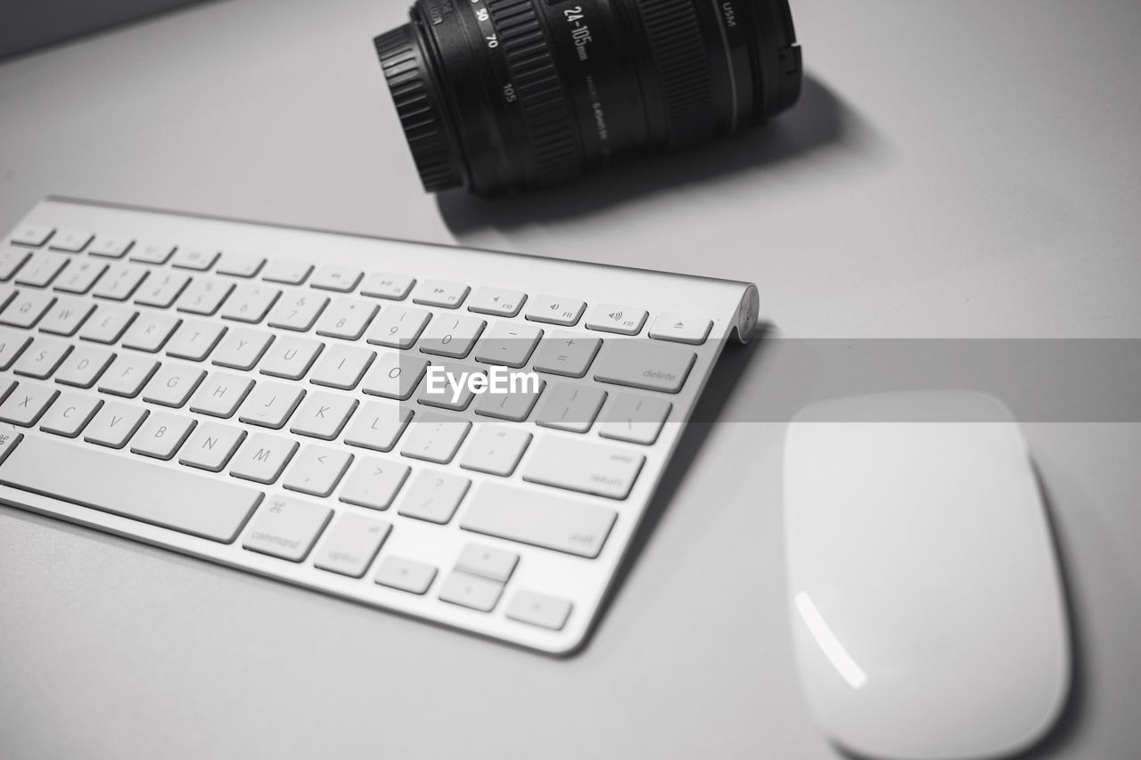 computer keyboard, technology, computer, indoors, keyboard, communication, high angle view, table, desk, wireless technology, close-up, no people, laptop, office, computer key, day