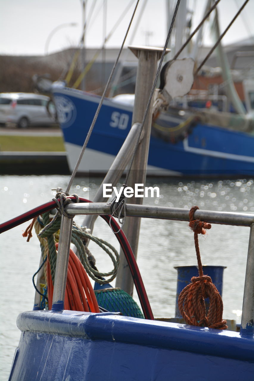 Cropped Image Of Boat Moored At Harbor