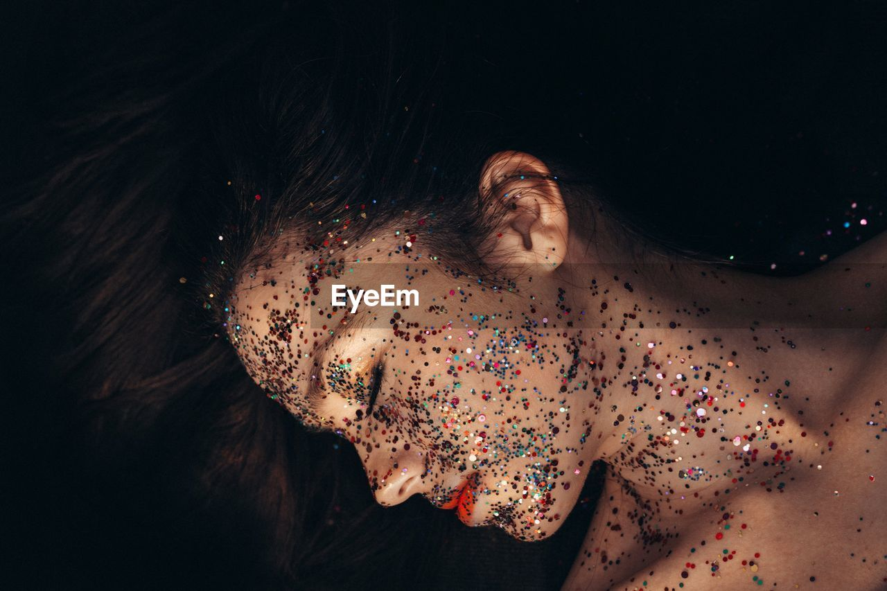High Angle View Of Shirtless Woman With Colorful Make-Up