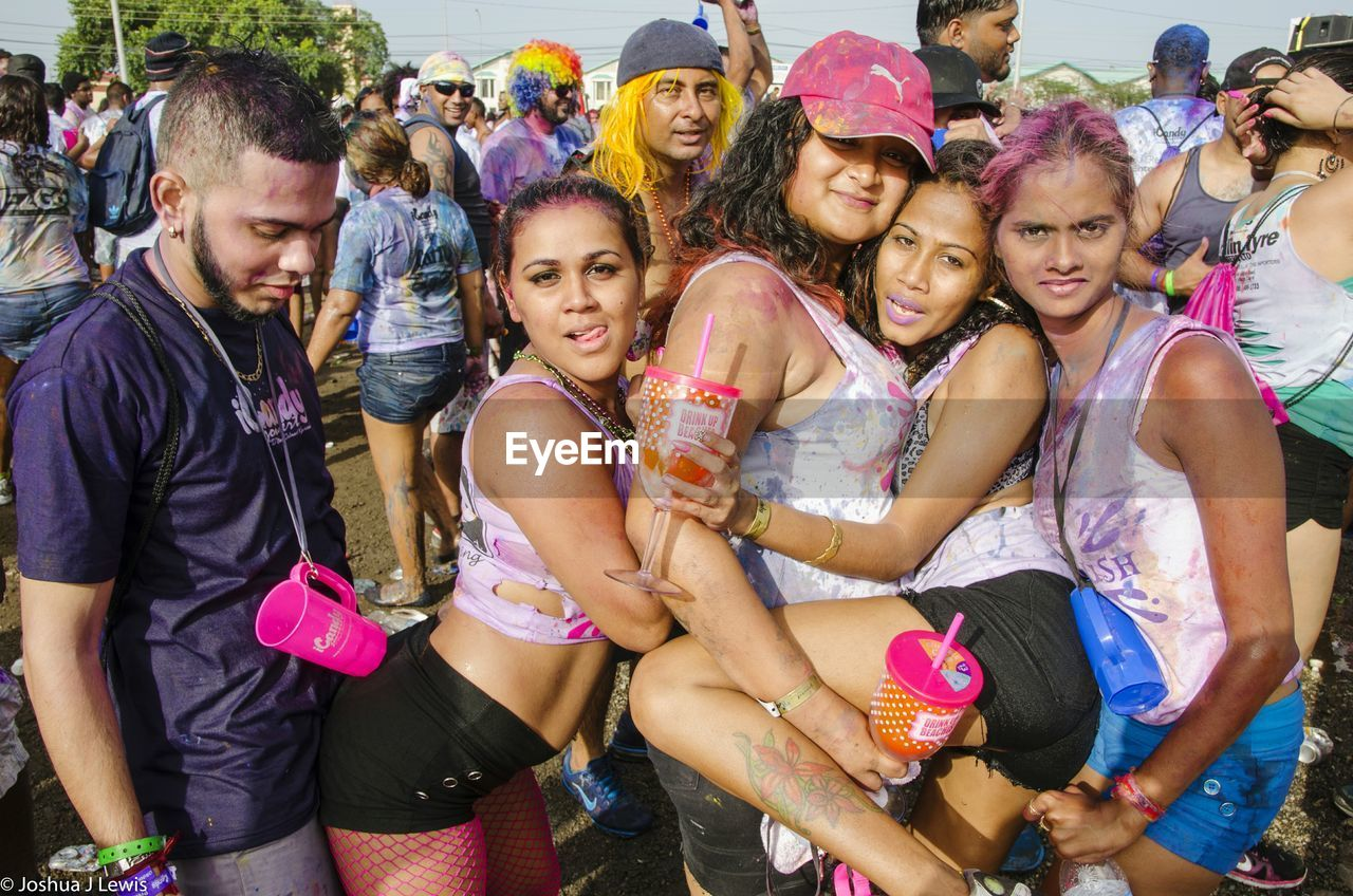 togetherness, fun, real people, outdoors, young adult, day, large group of people, happiness, leisure activity, young women, portrait, young men, standing, looking at camera, smiling, friendship, men, crowd, adult, people, adults only