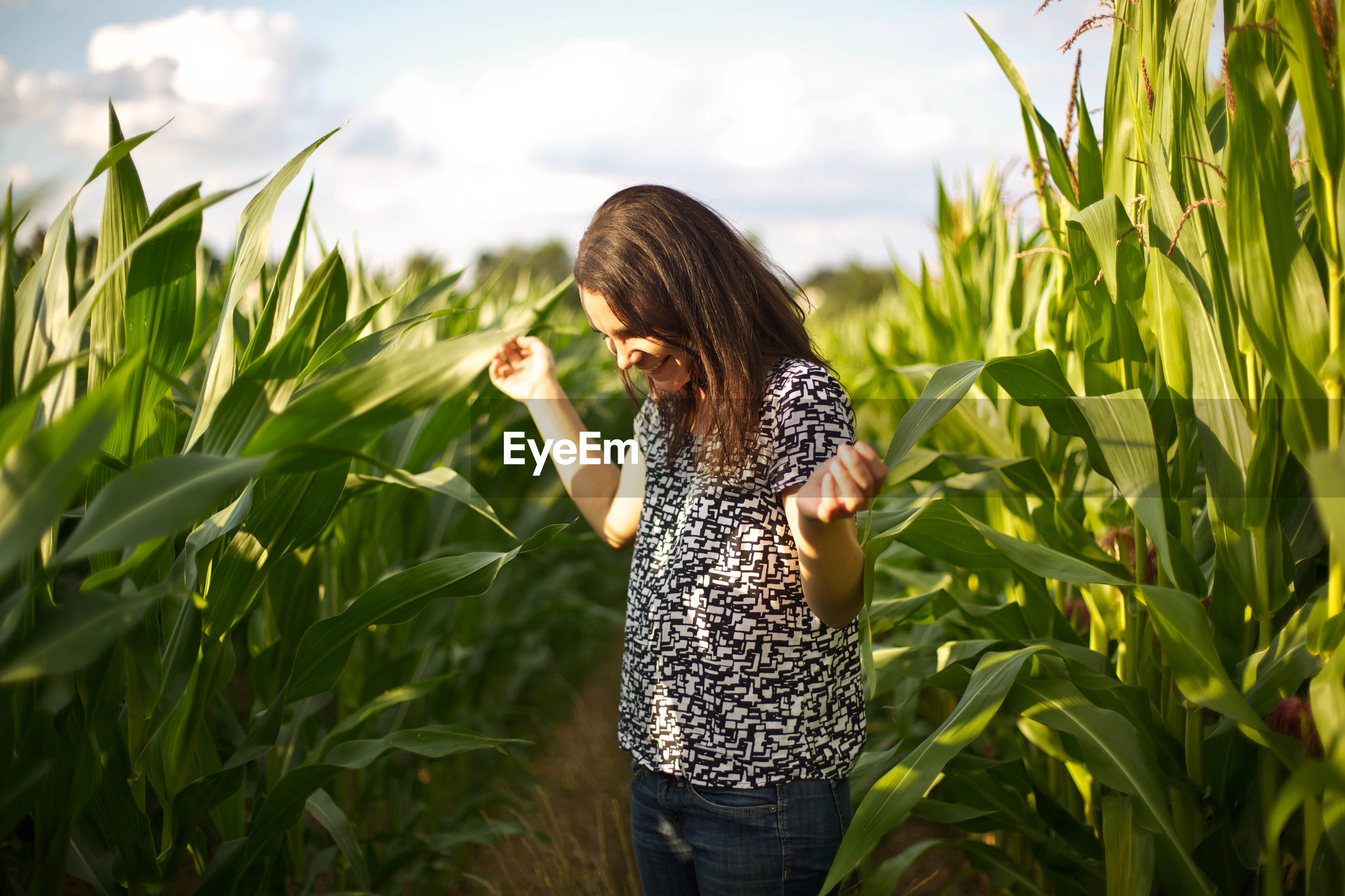 Woman standing in agricultural field