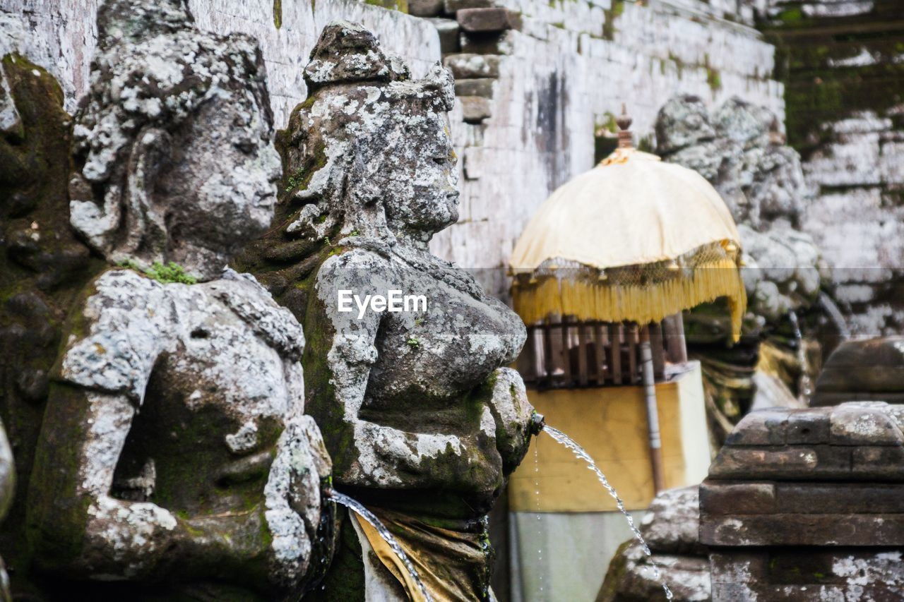 built structure, architecture, no people, spirituality, place of worship, solid, religion, water, nature, belief, day, representation, focus on foreground, stone material, sculpture, outdoors, flowing water