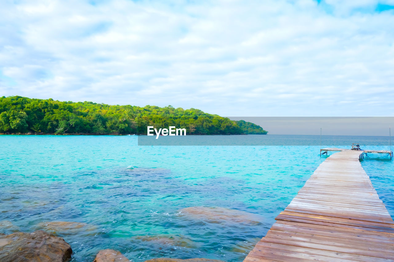 water, sky, beauty in nature, sea, scenics - nature, tranquility, cloud - sky, tranquil scene, plant, wood - material, day, tree, nature, idyllic, pier, no people, blue, land, outdoors, horizon over water, turquoise colored