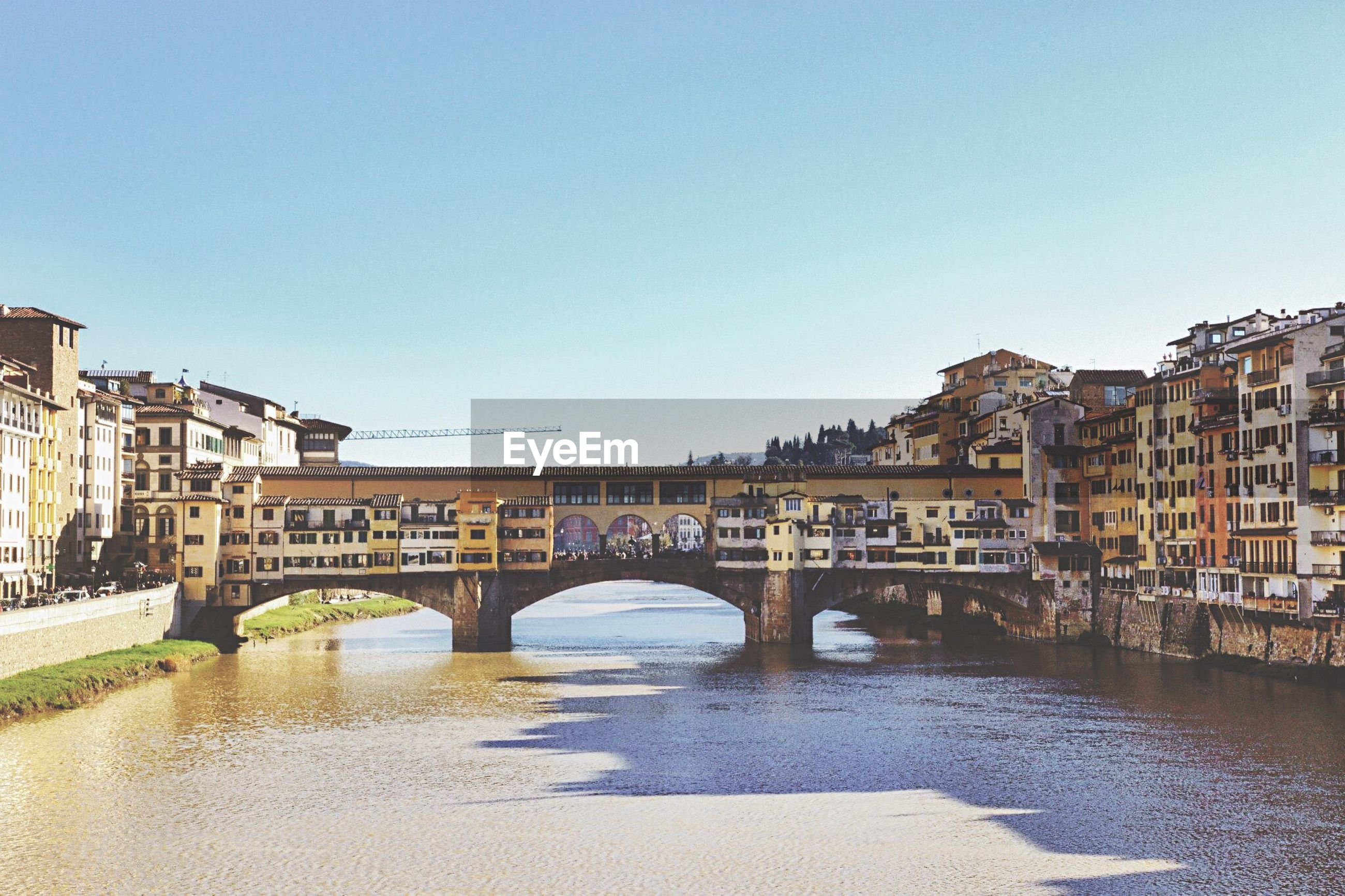 bridge - man made structure, architecture, travel destinations, river, city, built structure, building exterior, connection, water, travel, clear sky, tourism, waterfront, outdoors, cityscape, sky, no people, day