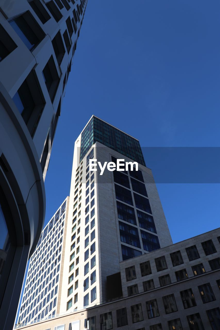 architecture, building exterior, building, built structure, sky, low angle view, city, clear sky, tall - high, nature, no people, window, blue, modern, day, office building exterior, office, sunlight, skyscraper, outdoors