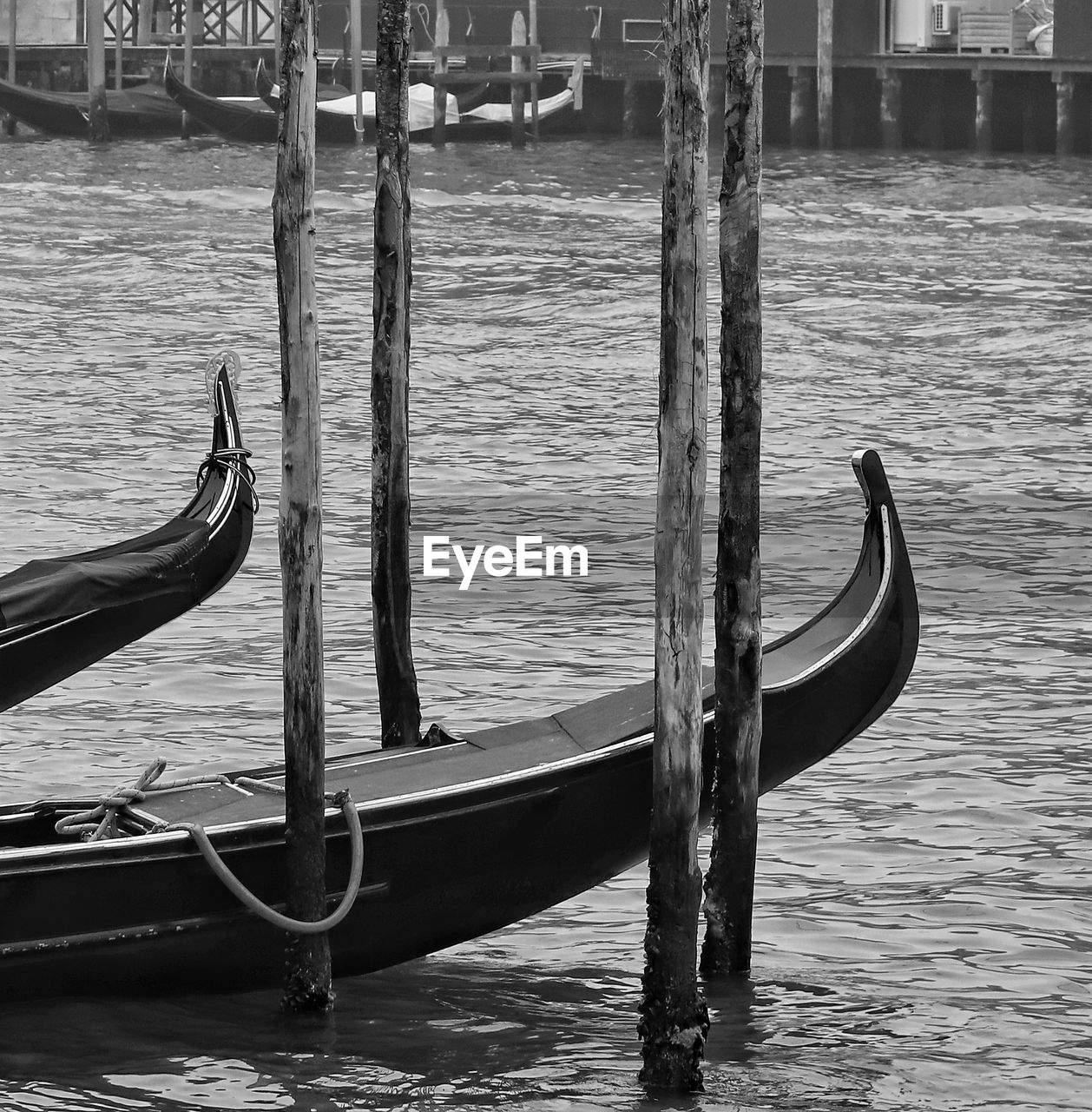 nautical vessel, water, transportation, mode of transportation, day, moored, wood - material, no people, gondola - traditional boat, outdoors, nature, travel, travel destinations, tourism, waterfront, canal, sea, gondola, wooden post, long