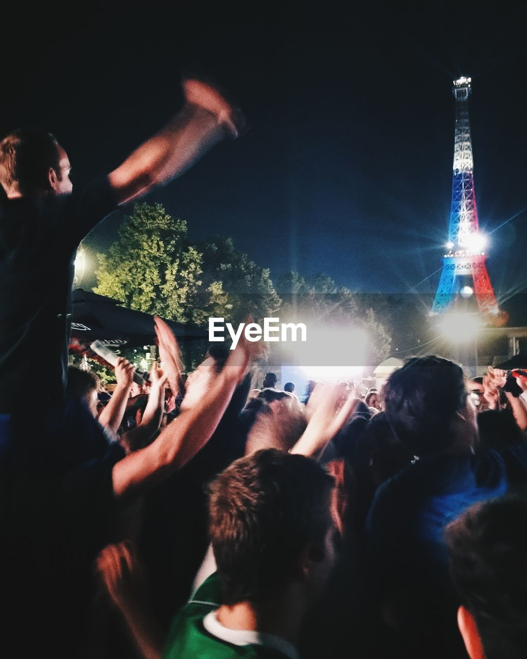 night, large group of people, crowd, illuminated, real people, arts culture and entertainment, excitement, leisure activity, men, celebration, enjoyment, fun, event, women, travel destinations, nightlife, outdoors, lifestyles, performance, audience, popular music concert, sky, people