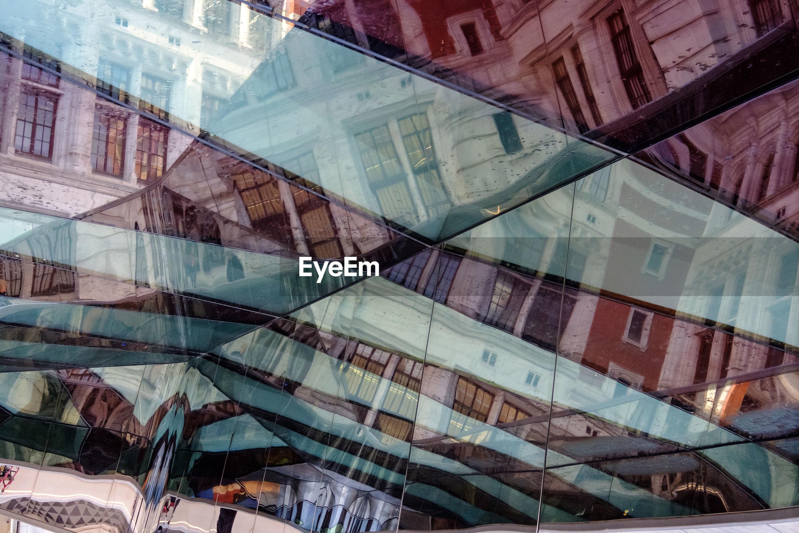 DIGITAL COMPOSITE IMAGE OF MODERN BUILDINGS