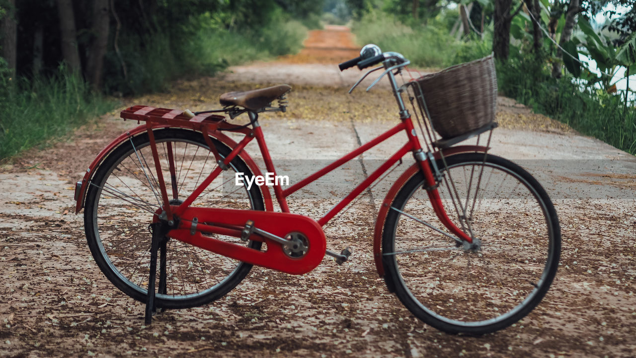 Red bicycle parked on footpath