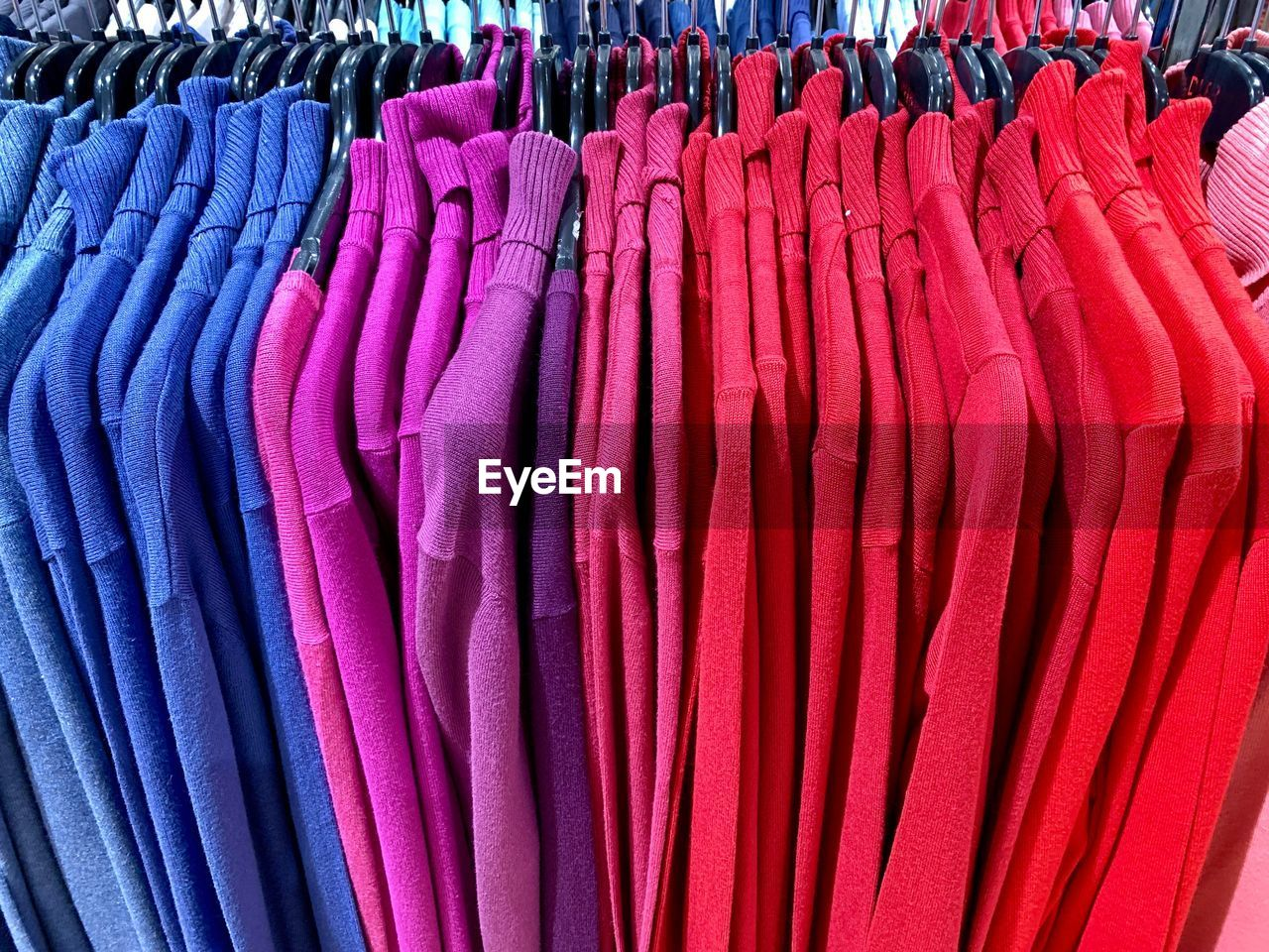 choice, variation, large group of objects, retail, in a row, textile, clothing, arrangement, for sale, abundance, hanging, multi colored, shopping, market, store, full frame, side by side, no people, backgrounds, business, fashion, sale, order, retail display, boutique, purple
