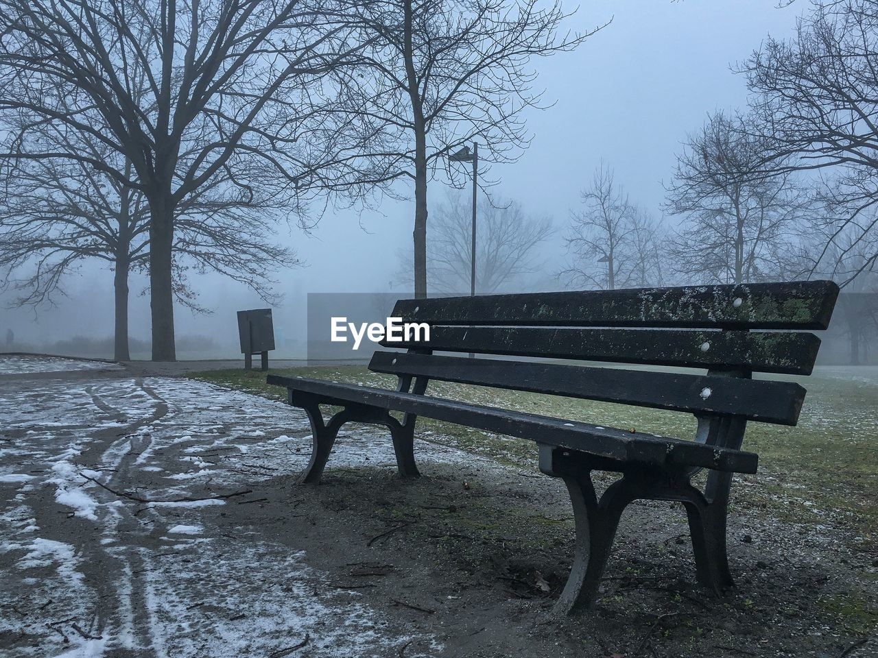 bench, bare tree, tree, nature, landscape, empty, winter, weather, fog, cold temperature, tranquility, scenics, beauty in nature, tranquil scene, day, field, outdoors, snow, park - man made space, seat, no people, branch, sky