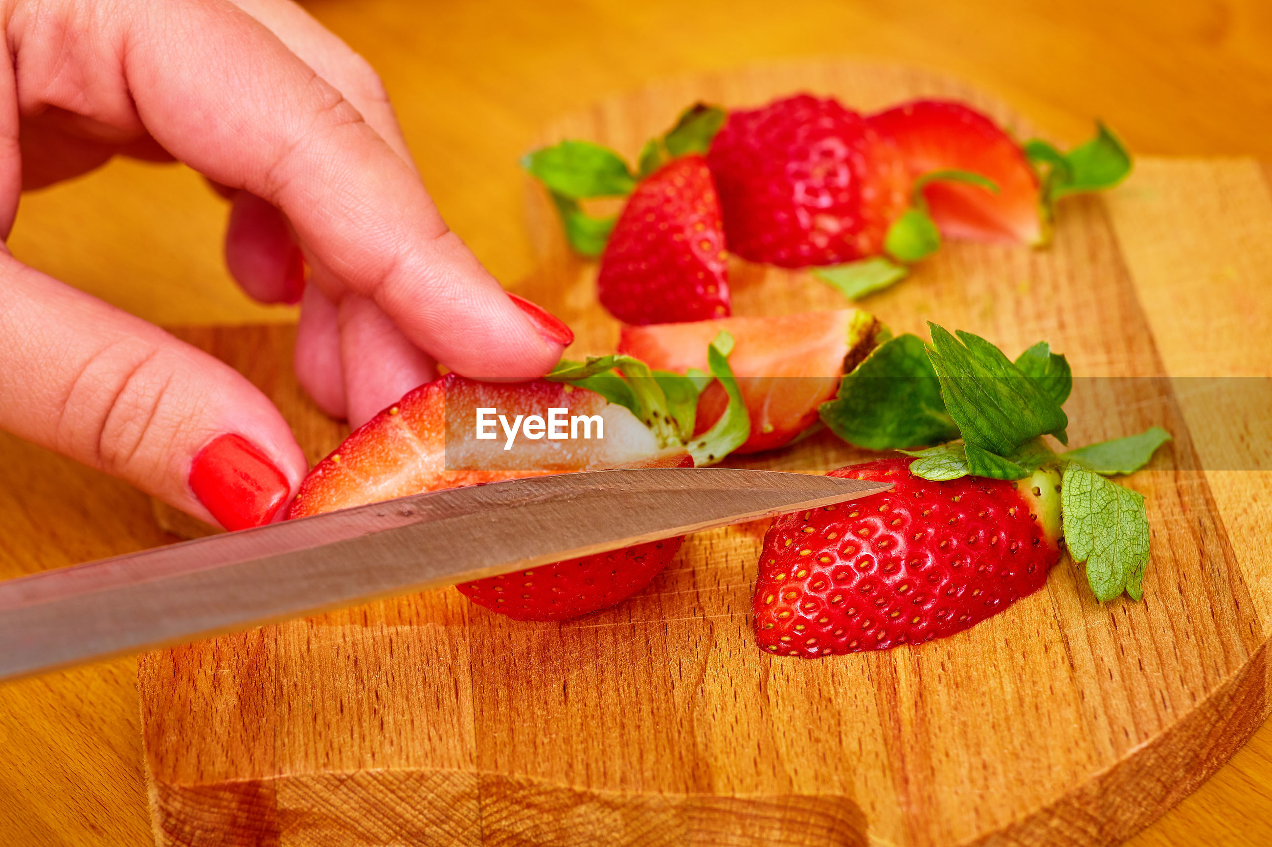 CLOSE-UP OF PERSON HOLDING STRAWBERRIES
