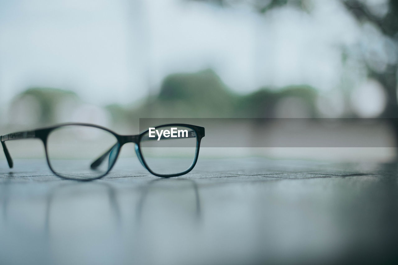 Close-up of eyeglasses on footpath