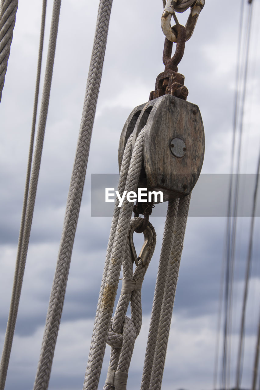 strength, metal, rope, no people, focus on foreground, connection, day, pulley, sky, tied up, close-up, cloud - sky, transportation, nautical vessel, nature, outdoors, mode of transportation, chain, water, sea, nautical equipment