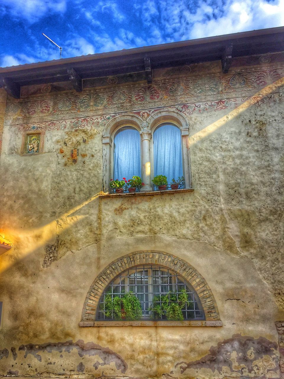 architecture, window, built structure, building exterior, low angle view, arch, day, no people, religion, place of worship, outdoors, sky