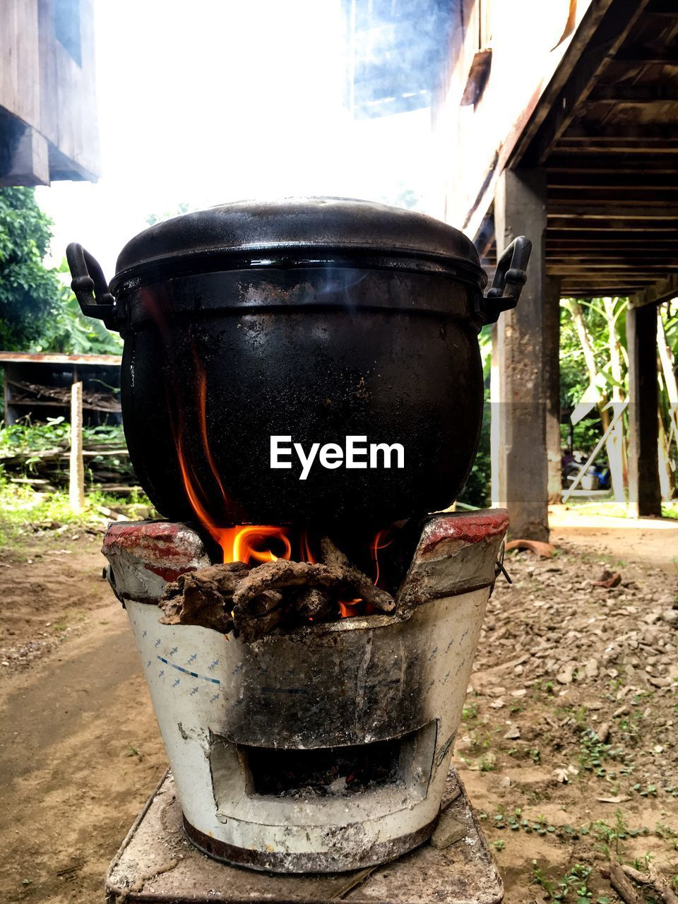 burning, flame, heat - temperature, no people, built structure, building exterior, architecture, day, outdoors, stove, fire pit, close-up, camping stove, tree