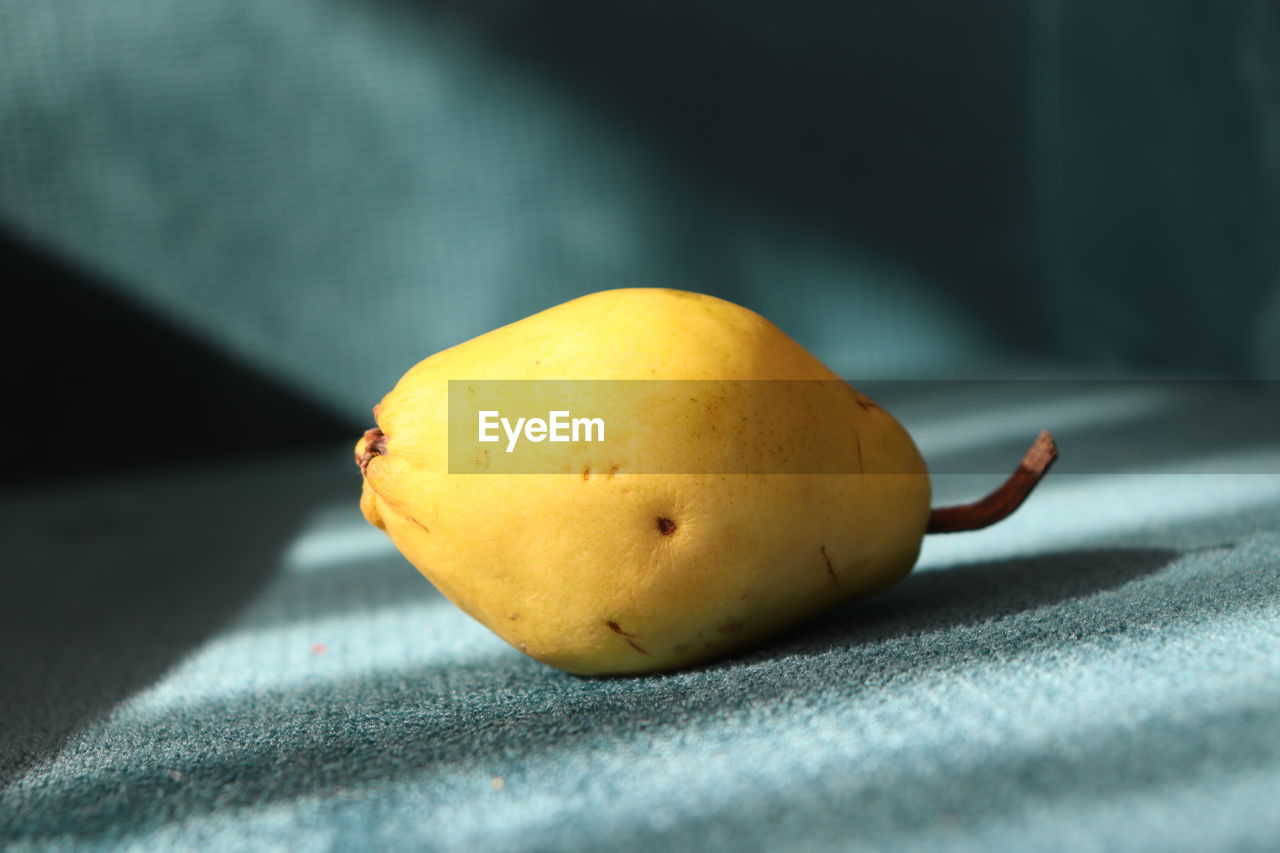 healthy eating, fruit, food and drink, food, wellbeing, freshness, close-up, still life, no people, indoors, yellow, selective focus, textile, sunlight, shadow, focus on foreground, table, day, nature, pear