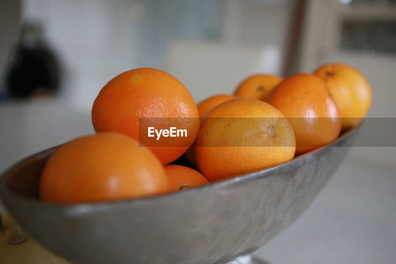 Close-up of orange fruits in weight scale