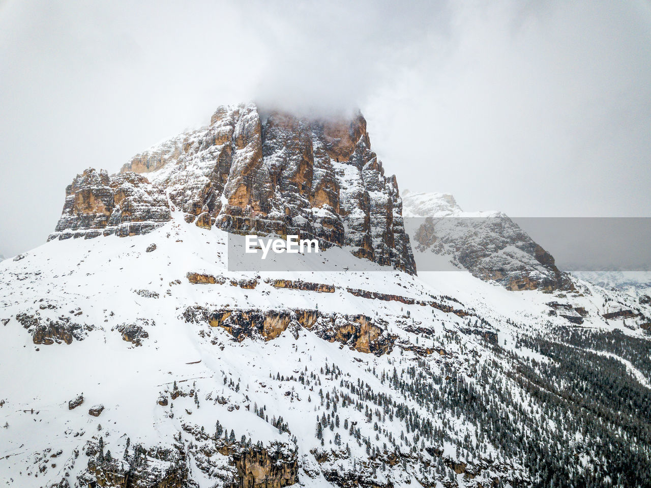 winter, snow, cold temperature, beauty in nature, mountain, scenics - nature, tranquil scene, sky, nature, tranquility, white color, no people, day, environment, covering, non-urban scene, landscape, snowcapped mountain, outdoors, extreme weather, mountain peak, formation