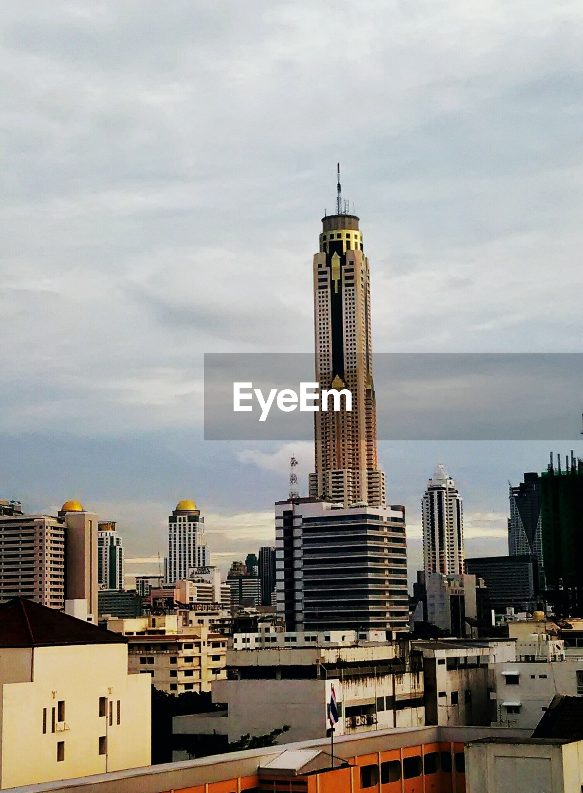 building exterior, architecture, built structure, sky, city, cloud - sky, tower, cloudy, tall - high, cloud, cityscape, skyscraper, travel destinations, modern, day, building, city life, outdoors, travel, capital cities