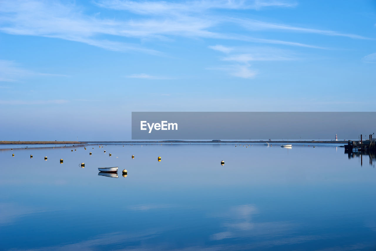 water, sky, cloud - sky, beauty in nature, nature, scenics, reflection, outdoors, blue, lake, tranquility, waterfront, tranquil scene, day, no people, transportation, nautical vessel