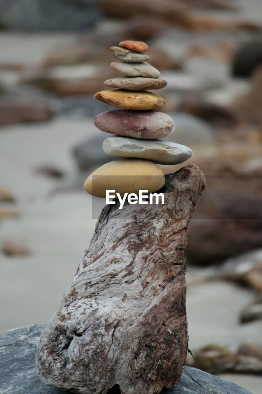 stack, balance, focus on foreground, close-up, no people, stone - object, solid, rock, day, zen-like, textured, rock - object, nature, outdoors, still life, stone, stability, pebble, tree, wood - material