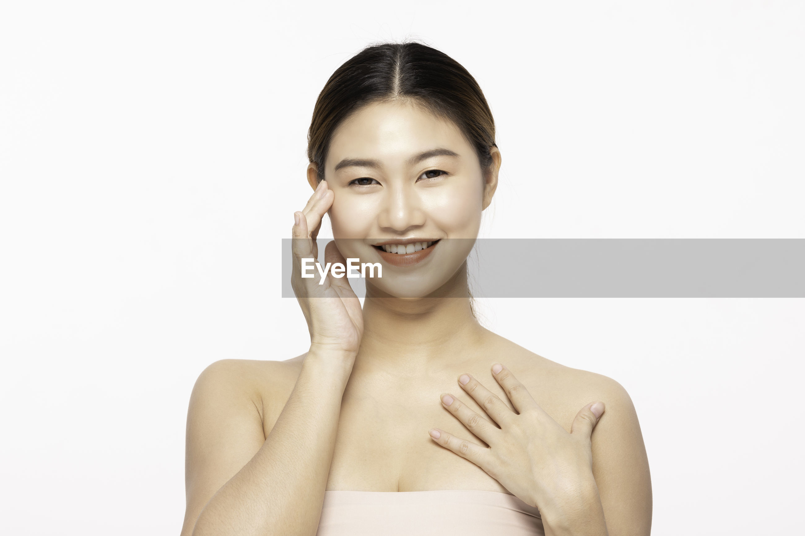 Portrait of smiling woman over white background