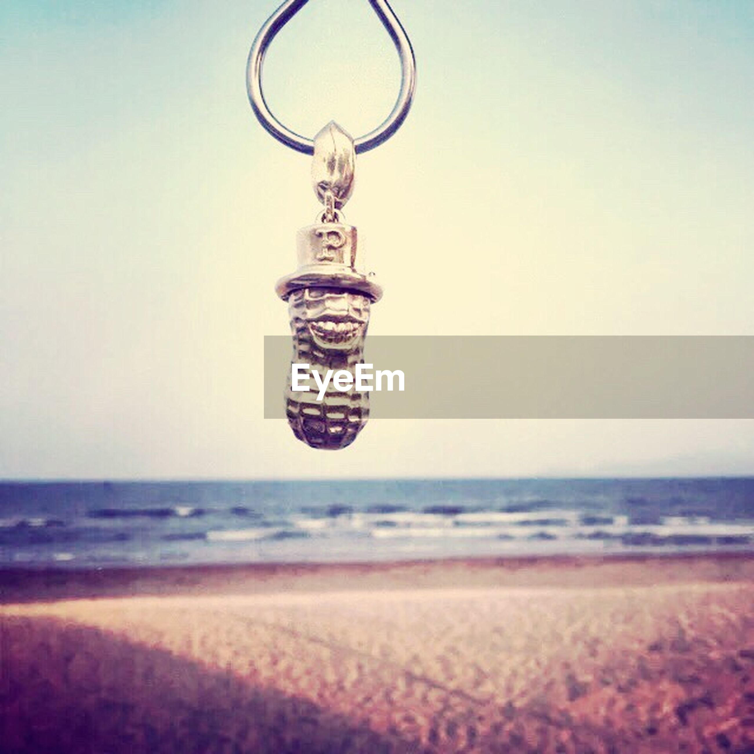 art and craft, sea, water, creativity, copy space, close-up, art, clear sky, focus on foreground, selective focus, still life, human representation, beach, hanging, no people, decoration, horizon over water, indoors, blue, day
