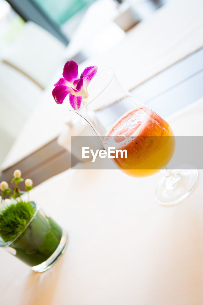 freshness, table, flowering plant, plant, flower, food and drink, drink, refreshment, still life, food, indoors, close-up, no people, high angle view, household equipment, glass, drinking glass, nature, glass - material, leaf, flower head, herb