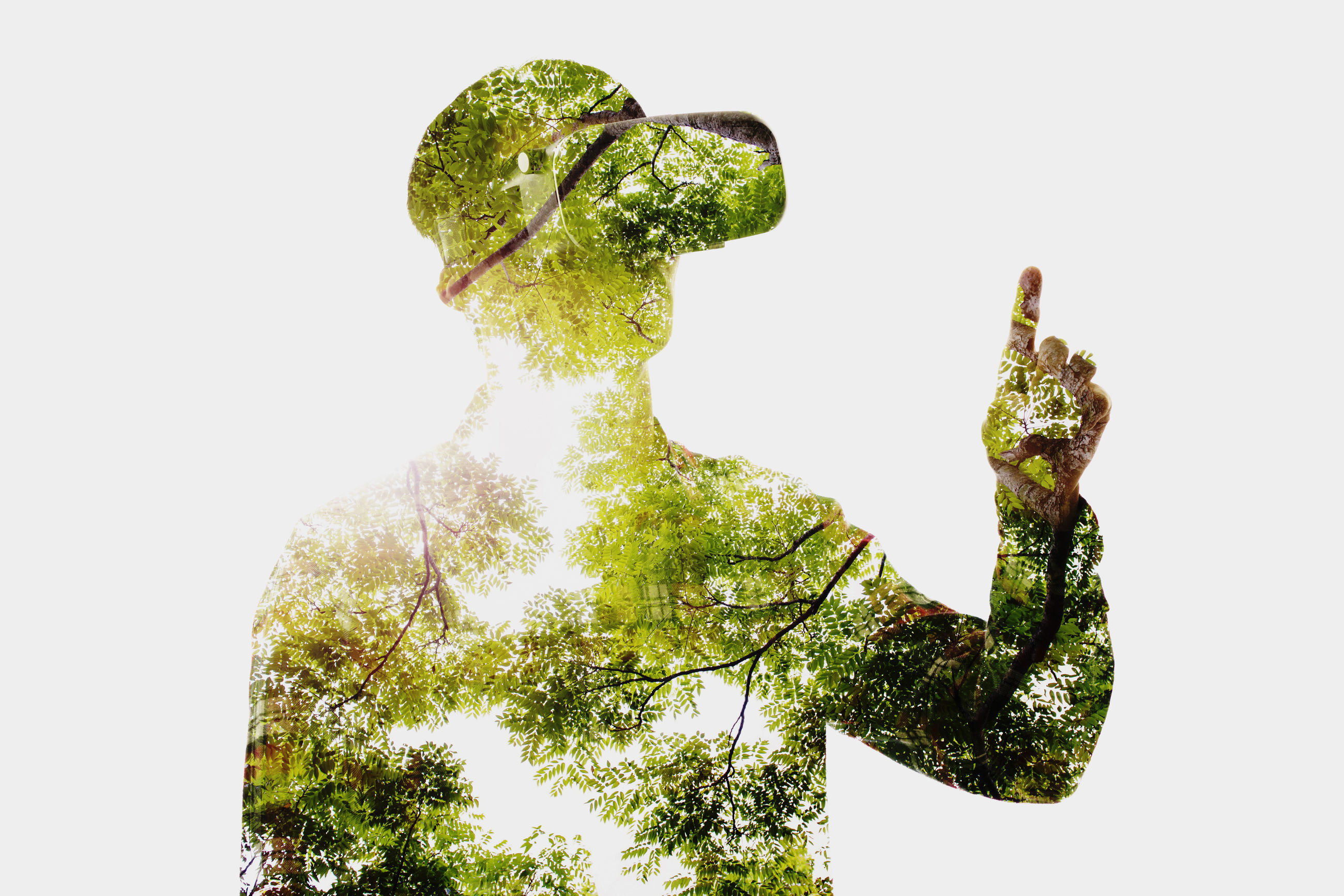 Double exposure of gesturing man and trees against white background